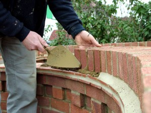 A dentil course underneath the tile creasing's on a radius wall.