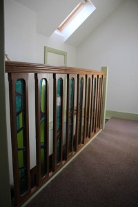 The top of the stair case looks great. The stain glass inset ballast rails were lovingly made by the home owner.